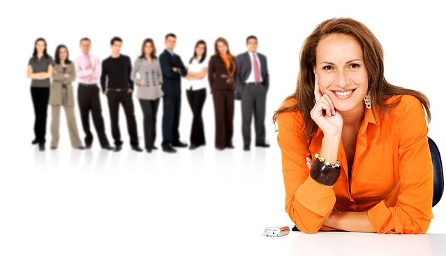 business woman leading a team full of young people isolated over a white background.jpeg
